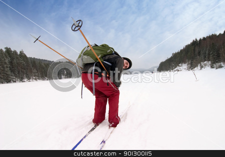 Wanting Speed stock photo, A cross country skiier pretending to be racing on a frozen lake. by Tyler Olson