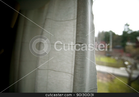 Recluse stock photo, A person peering out behind window curtains - A recluse hiding in a dark house looking out into the day. by Tyler Olson