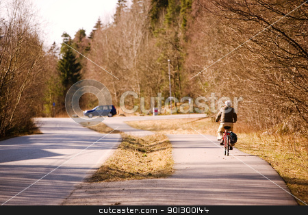 Retired Biker stock photo, An elderly man riding a bicycle by Tyler Olson