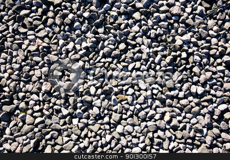 Small Stone Texture stock photo, A small stone background texture of smooth stones near the ocean. by Tyler Olson