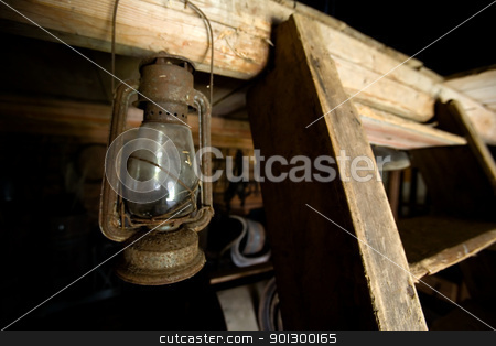 Old Lantern stock photo, An old lantern hanging in a barn by Tyler Olson