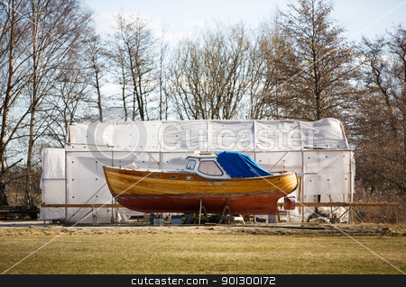 Norwegian Boat stock photo, A traditional norwegian boat in the harbour for repairs. by Tyler Olson