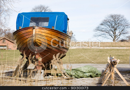 Wooden Boat Repair stock photo, An old traditional Norwegian boat in the harbour for repair. by Tyler Olson