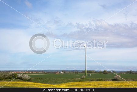 Wind Power stock photo, Windmill on a flat landsacpe capturing engergy against a blue sky by Tyler Olson