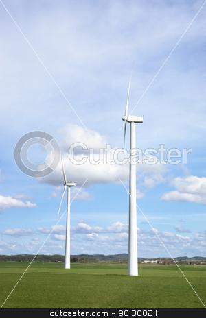 Wind Power stock photo, Windmill on a flat landsacpe capturing engergy against a blue sky by Tyler Olson