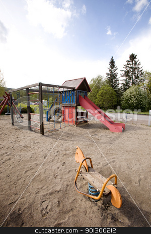 Childrens Playground stock photo, A typical playground with sand on the ground by Tyler Olson