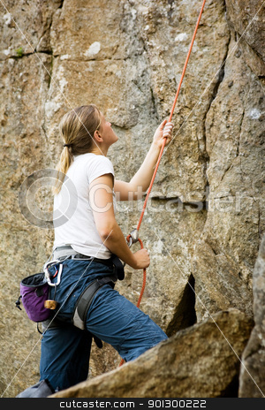 Female Belayer stock photo, A female belaying a climbing outdoors by Tyler Olson