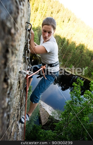 Fear stock photo, A climber at the top of a ledge looking down with fear. by Tyler Olson