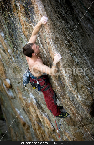 Male Rock Climber stock photo, A male climber, viewed from above, climbs a very high and steep crag. by Tyler Olson