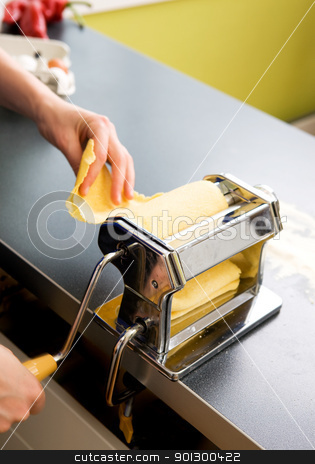 Pasta Machine on Counter stock photo, A detail - abstract image of a manual pasta machine by Tyler Olson