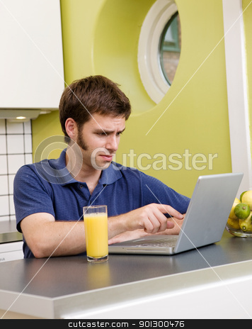 Unwanted Information stock photo, A young male looks at some disturbing information on the computer by Tyler Olson
