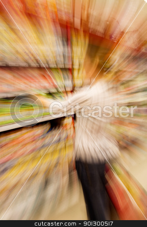 Shopping Choices stock photo, A woman making a purchase choice by Tyler Olson