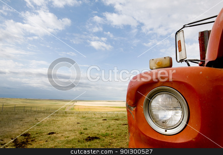 Grain Truck Abstract stock photo, A detail and abstract of a grain truck and prairie landscape. by Tyler Olson