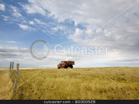 Water Truck stock photo, A water truck on the prairie by Tyler Olson