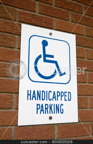 Handicapped Parking stock photo, A handicapped parking sign on a brick wall by Tyler Olson