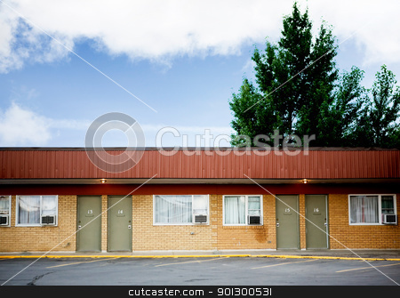 Old Hotel stock photo, An old retro hotel and parking lot by Tyler Olson