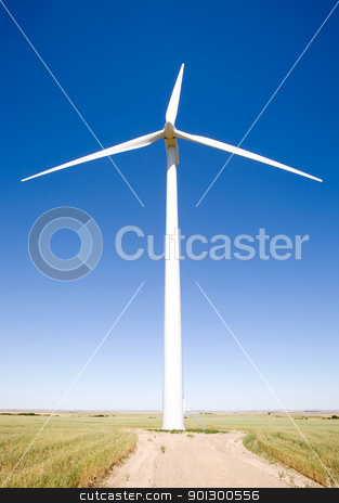 Wind Turbine from Below stock photo, A wind turbine on the flat prairie viewed from below by Tyler Olson