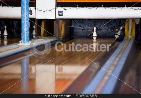 Last Pin Standing stock photo, The single middle pin remains standing in a retro five pin bowling alley. by Tyler Olson