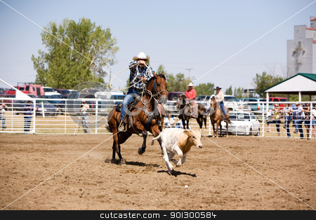 Calf Roping stock photo, A calf roping image for a local rodeo by Tyler Olson