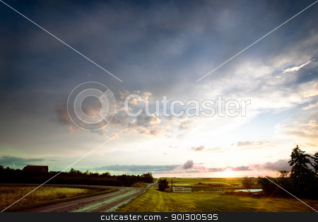 Saskatchean Storm Sunset stock photo, A sunset after a rain storm in rural Saskatchewan, Canada by Tyler Olson