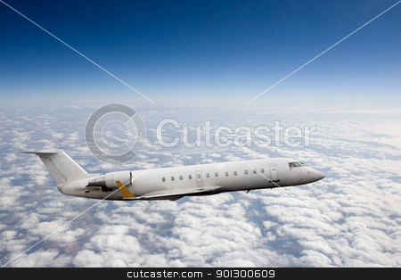 Airplane in Sky stock photo, Airplane in flight over high altitude clouds by Tyler Olson