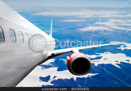 Airplane over Iceland stock photo, An airplane accending over a dramatic cloudscape. by Tyler Olson