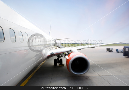 Airplane at Terminal stock photo, A airliner in an airport terminal; by Tyler Olson