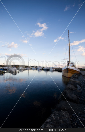 Evening at Dock stock photo, A dock with sailboats in the evening sun by Tyler Olson