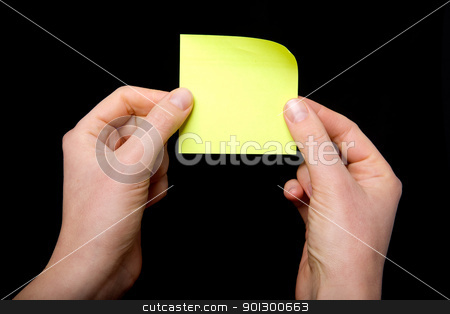 Sticky Note stock photo, A sticky note being held between two hands by Tyler Olson