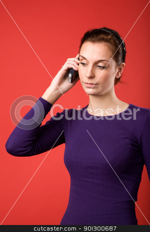 Cell Phone Woman stock photo, A casual portrait of a brunette caucasian female talking on a cell phone with a red background by Tyler Olson