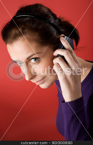 Talking on Cell Phone stock photo, A young woman talking on the cell phone. by Tyler Olson