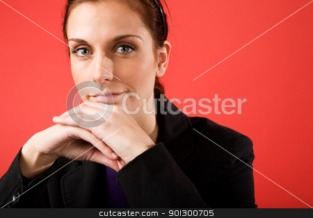 Content Business Woman stock photo, A young content business woman looks at the camera by Tyler Olson