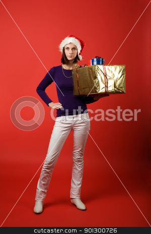 Christmas Present stock photo, A young woman with a present isolated on red by Tyler Olson