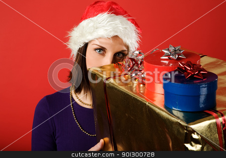 Christmas Present on Red stock photo, A young woman with a present isolated on red by Tyler Olson