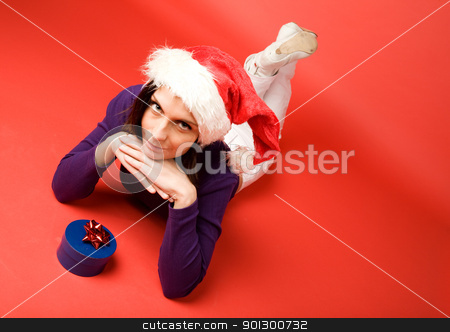Small Gift stock photo, A young woman with a present isolated on red by Tyler Olson