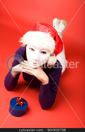 Secret Santa stock photo, A female behind a mask giving a gift by Tyler Olson