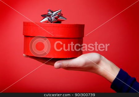 Gift on Red stock photo, A small package isolated on red by Tyler Olson