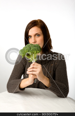 Healthy Eating stock photo, A woman with broccoli in hand by Tyler Olson