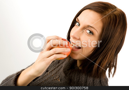 Apple in Hand stock photo, A young woman eating an apple by Tyler Olson