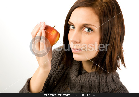 Woman eating Apple stock photo, A female eating an apple by Tyler Olson