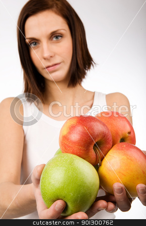 Apples stock photo, A young woman holding a bunch of apples by Tyler Olson