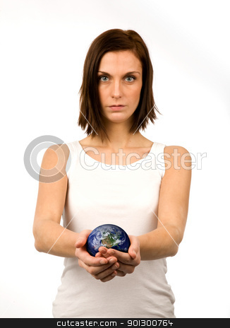 Global Concern stock photo, A young woman carefully holding the world by Tyler Olson