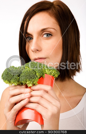 Fast Food Broccoli stock photo, A female with a fast food healthy snack by Tyler Olson