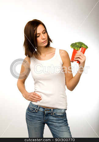 Broccoli Snack stock photo, A female with a fast food healthy snack by Tyler Olson