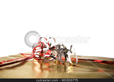 Isolated Gift Detail stock photo, Golden present isolated against a white background by Tyler Olson