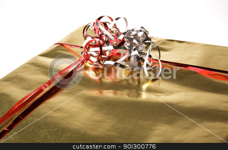 Present Detail stock photo, Golden present isolated against a white background by Tyler Olson
