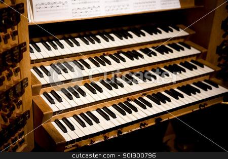 Pipe Organ Keys stock photo, Old keys on a wooden pipe organ by Tyler Olson