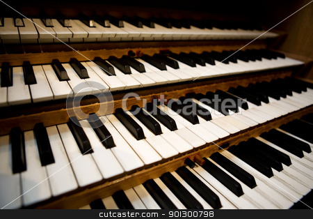 Pipe Organ Keyboard stock photo, An old pipe organ keyboard in a church by Tyler Olson