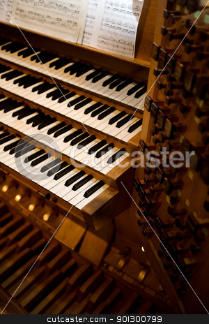 Old Pipe Organ stock photo, An old pipe organ keyboard in a church by Tyler Olson