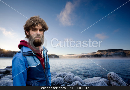 Male on Fjord stock photo, A male standing by a fjord in Norway by Tyler Olson